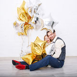 Father and daughter. Helium balloons. Royalty Free Stock Image