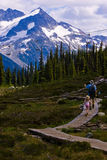 Father Daughter Hike. A father takes his daughter on hike high in the mountains Royalty Free Stock Photography