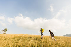 Father and daughter hiking. Young father and daughter enjoy hiking on a sunny day stock photography