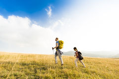 Father and daughter hiking. Young father and daughter enjoy hiking on a sunny day royalty free stock images