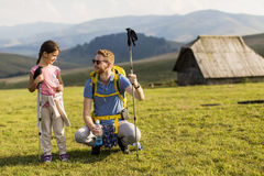Father with daughter hiking. Young father and daughter enjoy hiking on a sunny day stock images