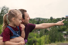 Father and daughter on a hill Royalty Free Stock Photos