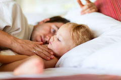 Father and daughter. Father and his adorable toddler daughter relaxing in bedroom stock image