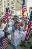 Father with daughter on his shoulders protests with hundreds of thousands of immigrants in march for Immigrants and Mexicans again Royalty Free Stock Images