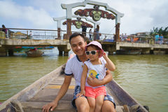 Father and daughter in Hoi An, Vietnam. Father and daughter on a boat in Hoi An, Vietnam Stock Images