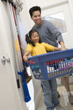 Father And Daughter Holding Basket Of Clothes Royalty Free Stock Photo
