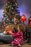 Father and daughter holding Christmas gift, vertical Stock Photography
