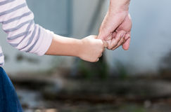 Father and daughter holding hand in hand. Care and love concept royalty free stock images