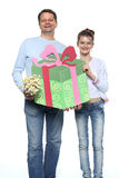 Father and daughter holding a present. For mom - smiling royalty free stock photography