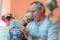 Father and daughter holding urn and crying. Family stock photo