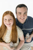 Father And Daughter Holding Water Bottle Royalty Free Stock Images