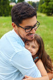 Father And Daughter Hugging In Park. Family Embracing Outdoors stock images