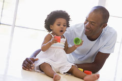Father and daughter indoors playing Stock Photography