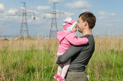Father and daughter on the industrial background Royalty Free Stock Photo