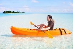 Father and daughter kayaking Stock Photos