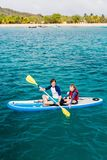 Father and daughter kayaking. At tropical ocean royalty free stock image