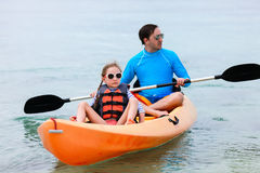 Father and daughter kayaking Stock Images