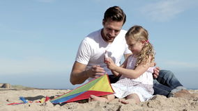Father and Daughter With a Kite on the Beach stock video footage