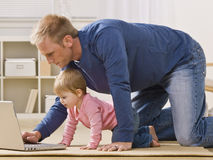 Father and Daughter with Laptop Royalty Free Stock Photography