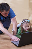 Father and daughter on laptop Royalty Free Stock Photos