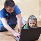 Father and daughter on laptop Stock Image