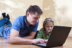Father and daughter on laptop Royalty Free Stock Photo