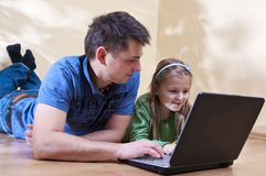 Father and daughter on laptop Royalty Free Stock Image