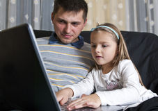 Father and daughter with laptop Royalty Free Stock Image
