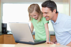 Father and daughter with laptop Stock Photos