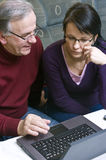 Father and daughter with laptop stock images