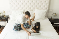 Father and daughter with laptop. Father and daughter together on the bed with a laptop royalty free stock image