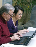 Father and Daughter with laptops royalty free stock photography