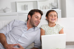 Father and daughter laughing Stock Images