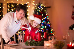 Father and daughter lighting Christmas candles Royalty Free Stock Images