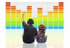 Father & Daughter Listening To Digital Music In Front Of A Large Graphics Equalizer Hologram royalty free stock photos