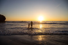 Father and Daughter. Father and little daughter on the beach in the sunset Royalty Free Stock Photography