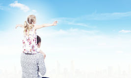 Father and daughter. Little daughter sitting on father's shoulders. Parenting concept royalty free stock photography