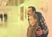 Father and daughter looking at ancient bas-reliefs in museum Royalty Free Stock Photography