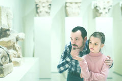 Father and daughter looking at ancient bas-reliefs in museum Royalty Free Stock Image