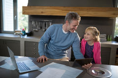 Father and daughter looking at each other and smiling Stock Photography
