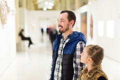 Father and daughter looking at expositions Royalty Free Stock Photo