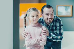 Father and daughter looking at paintings in halls of museum Stock Photos