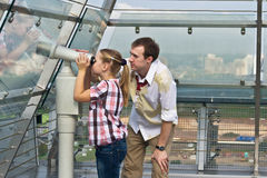 Father and daughter looking through telescope Stock Photography
