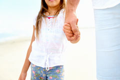 Father daughter love. Father and daughter holding hands on the beach together happy and loving vacation Stock Photography
