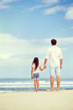 Father daughter love. Father and daughter holding hands on the beach together happy and loving vacation Royalty Free Stock Images