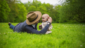 Father and daughter love. Father and daughter playing in the park Royalty Free Stock Photos