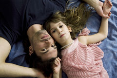 Father and daughter are   lying Stock Image