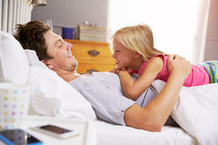 Father And Daughter Lying In Bed Together Royalty Free Stock Photo