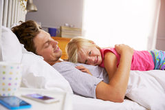 Father And Daughter Lying In Bed Together Stock Images