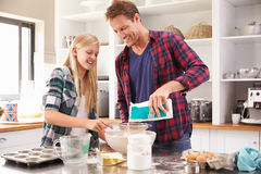 Father and daughter making a cake together Royalty Free Stock Photo